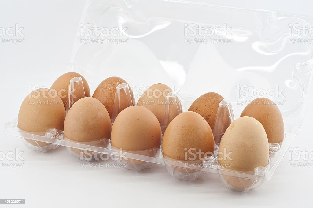 Chicken eggs in plastic tray. stock photo