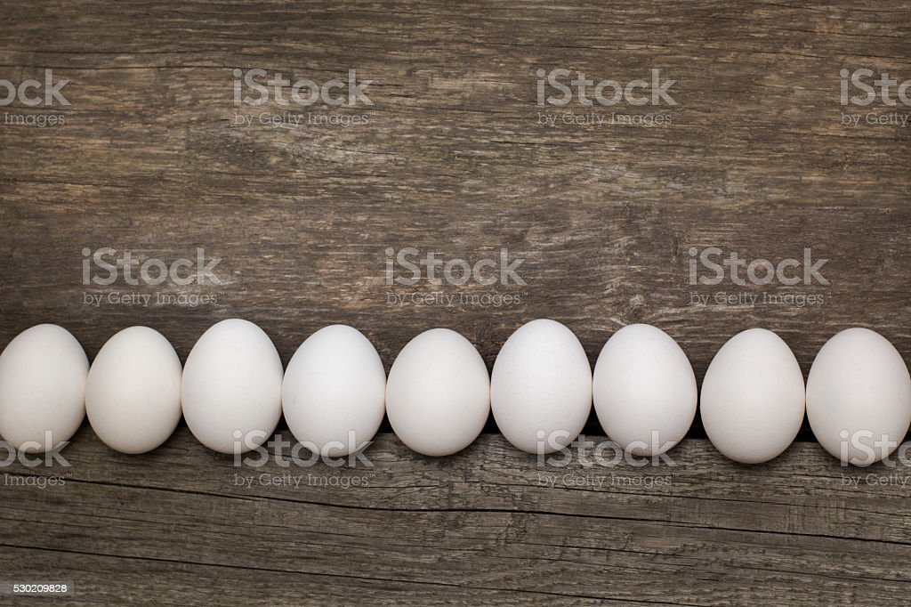 Chicken eggs on wooden table.  Top view and flat lay. stock photo