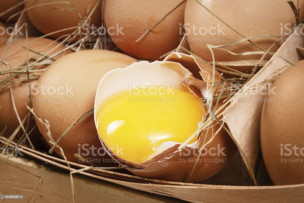 Chicken eggs with broken egg royalty-free stock photo