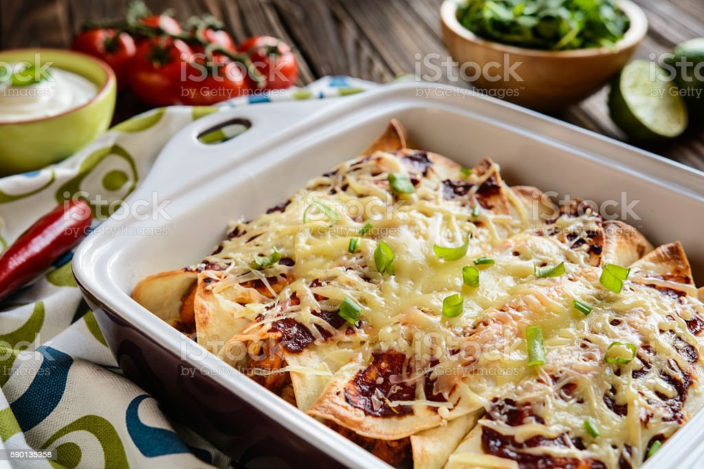Chicken enchiladas with cheese and vegetable stock photo