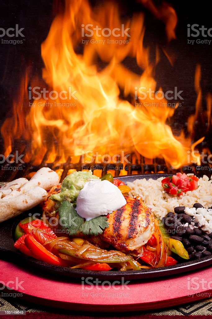 Chicken Fajitas with flames royalty-free stock photo