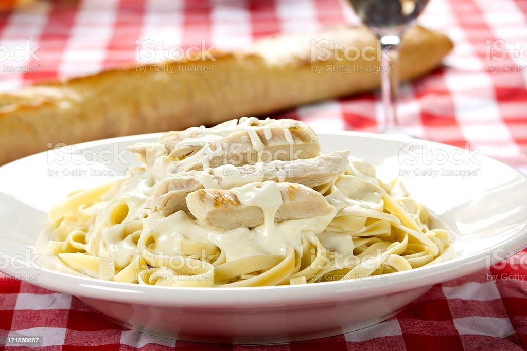 Chicken Fettuccine Alfredo with white wine royalty-free stock photo