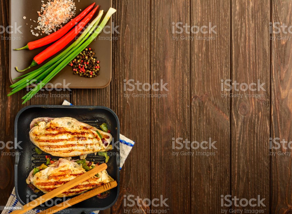 Chicken fillet and vegetables made on a grill. Top view stock photo