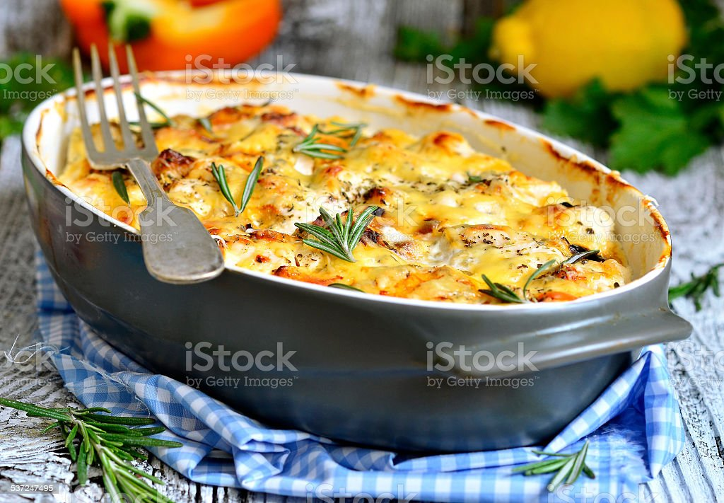 Chicken fillet baked in sour cream sauce. stock photo