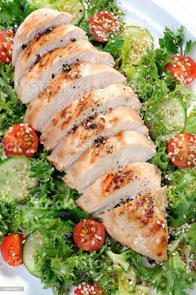 Chicken fillet in a vegetable garnish stock photo