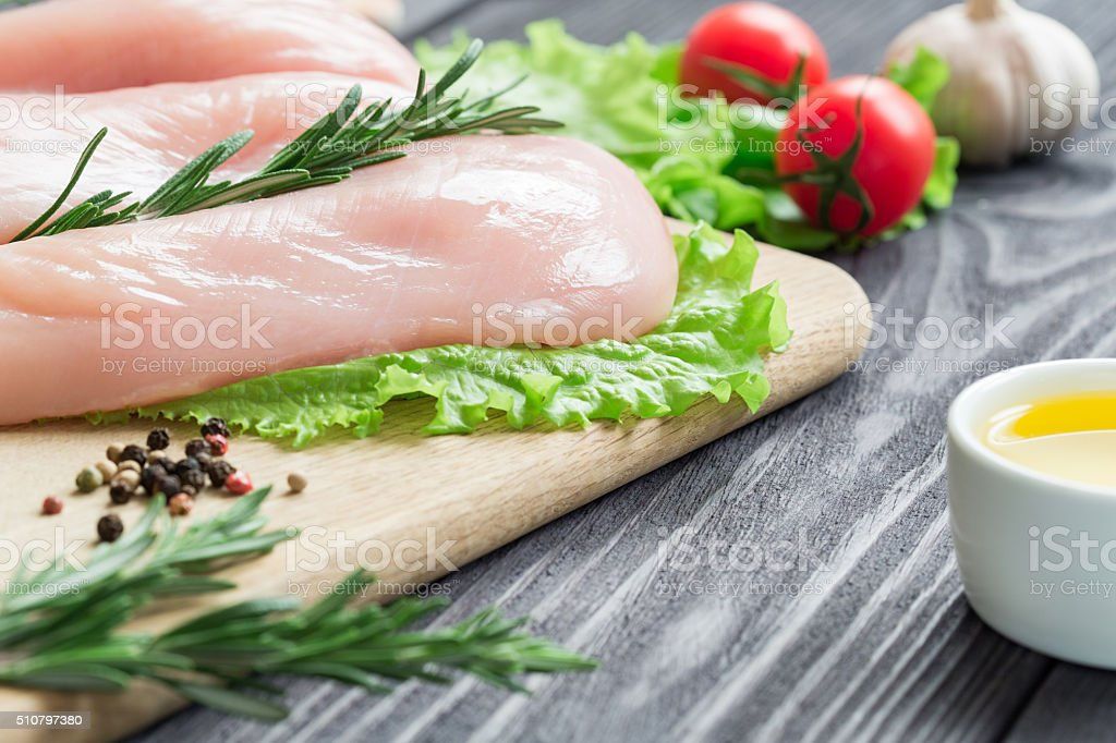 Chicken fillet on a cutting board. stock photo