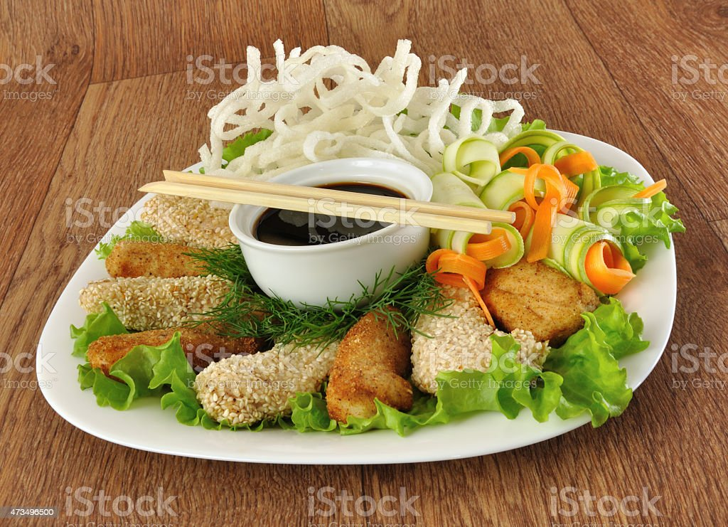 Chicken fillet with rice noodles and vegetables stock photo