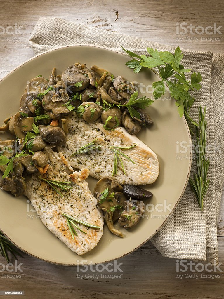 chicken fillet with sauteed mushroom stock photo