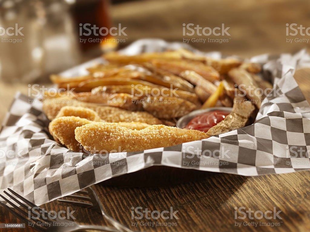 Chicken Fingers with Hand Cut French Fries royalty-free stock photo