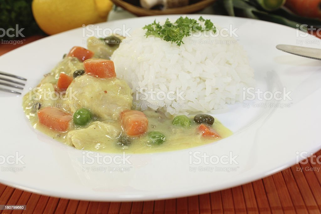Chicken fricassee with carrots stock photo
