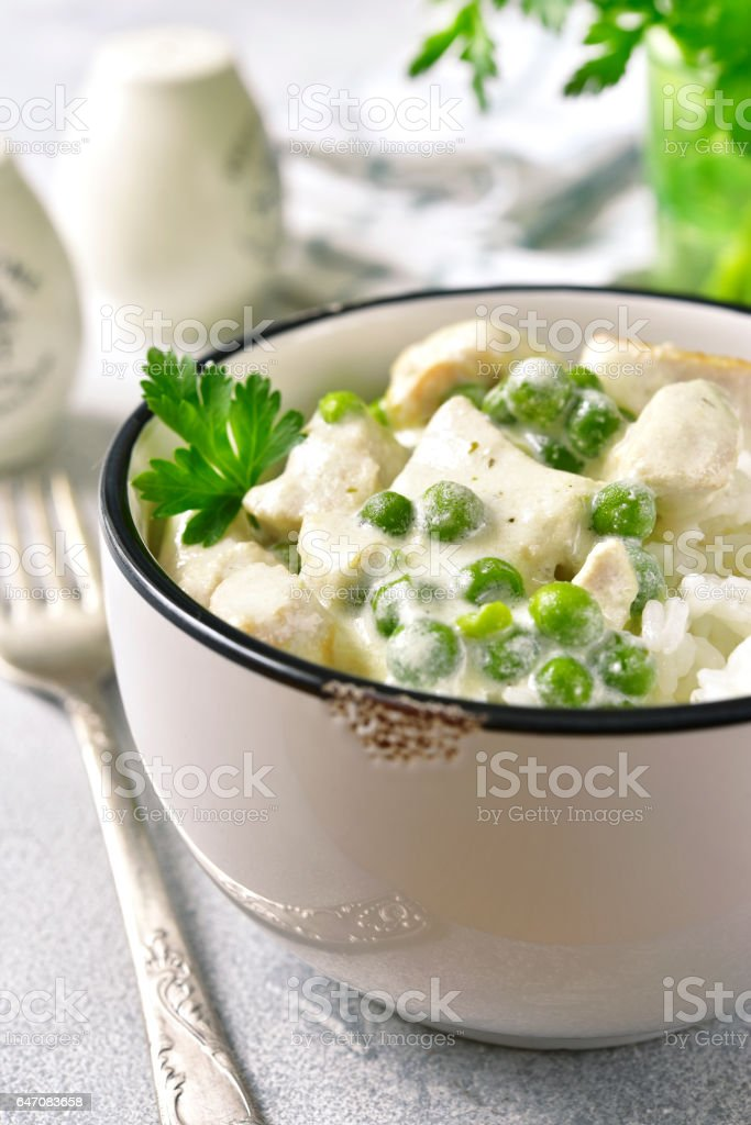 Chicken fricassee with green pea. stock photo