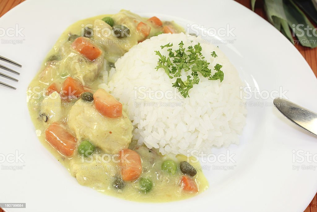 Chicken fricassee with peas stock photo