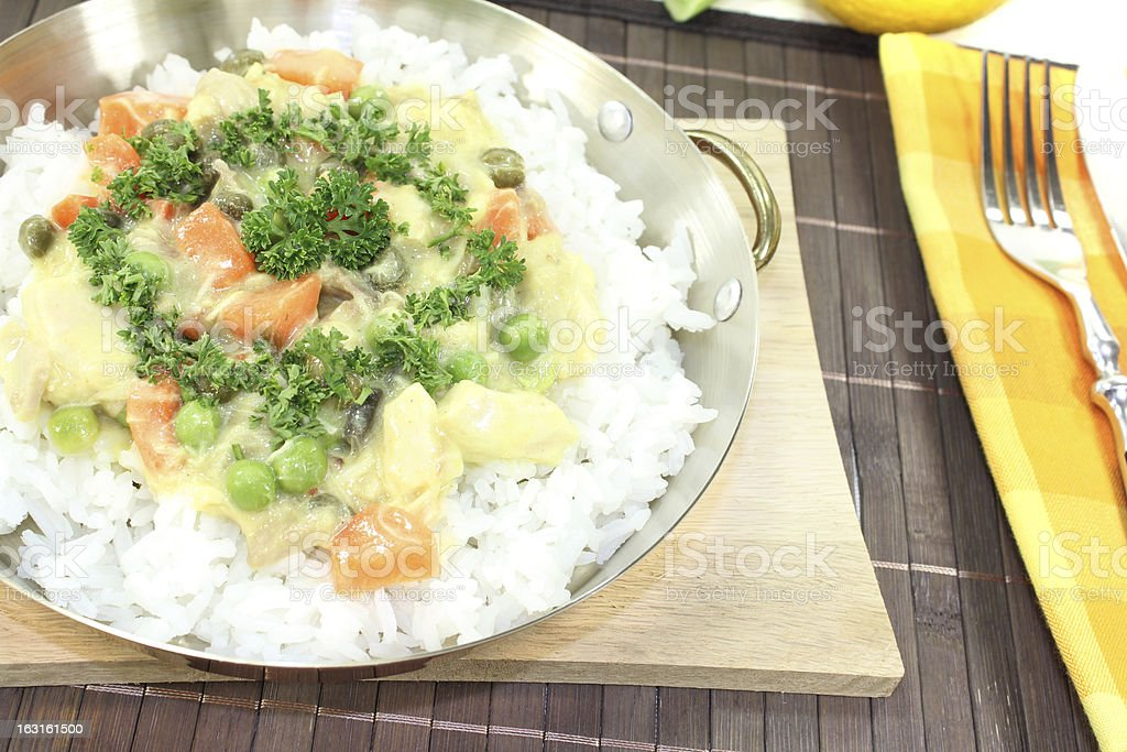 chicken frikassee with rice and mushrooms stock photo