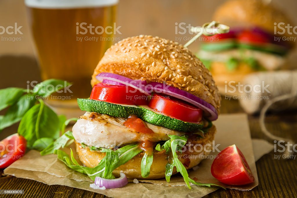 Chicken grill burger on wood background stock photo