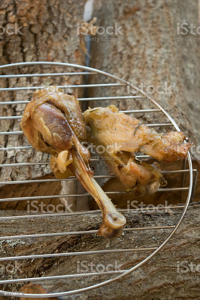 chicken grilled on the wood stock photo