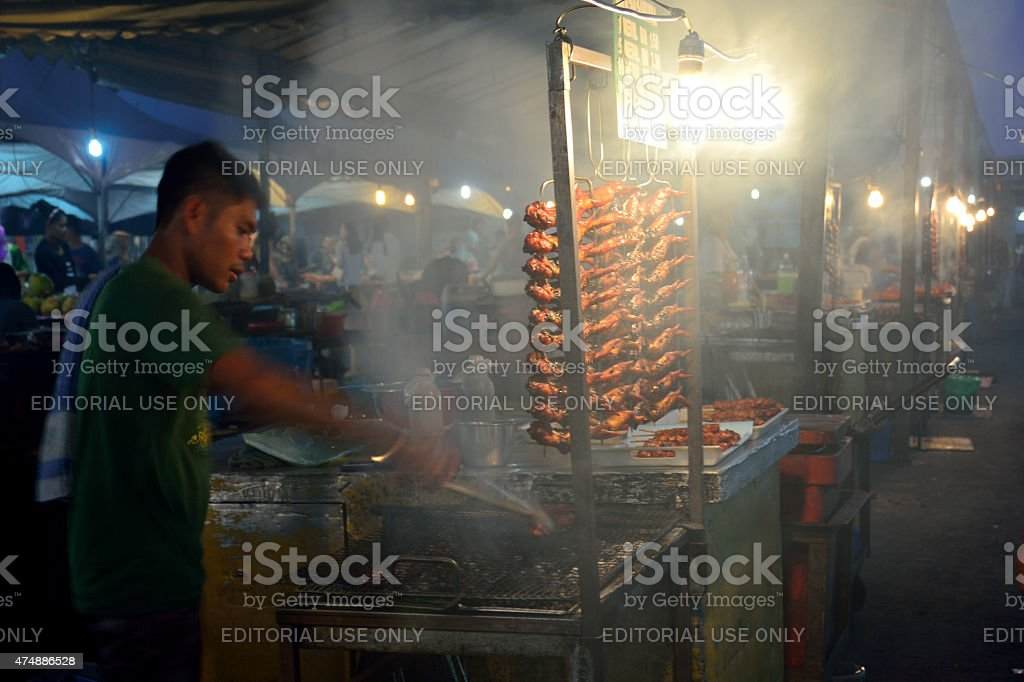 BBQ chicken hawker stall in Kota Kinabalu night market stock photo