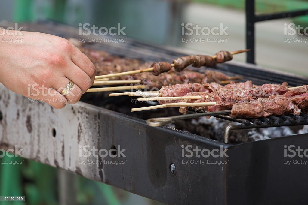 Chicken hearts kebabs on grill stock photo
