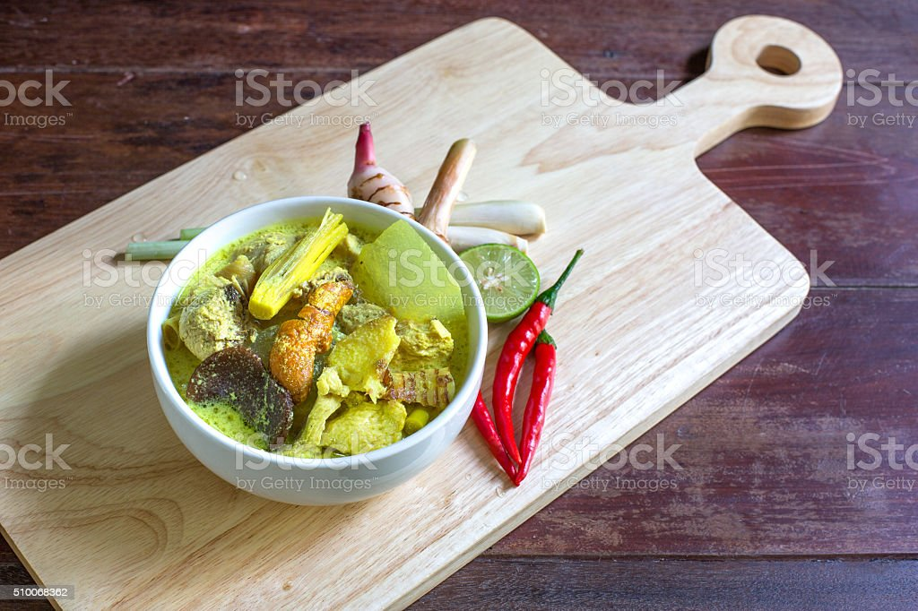 Chicken in coconut milk soup, stock photo