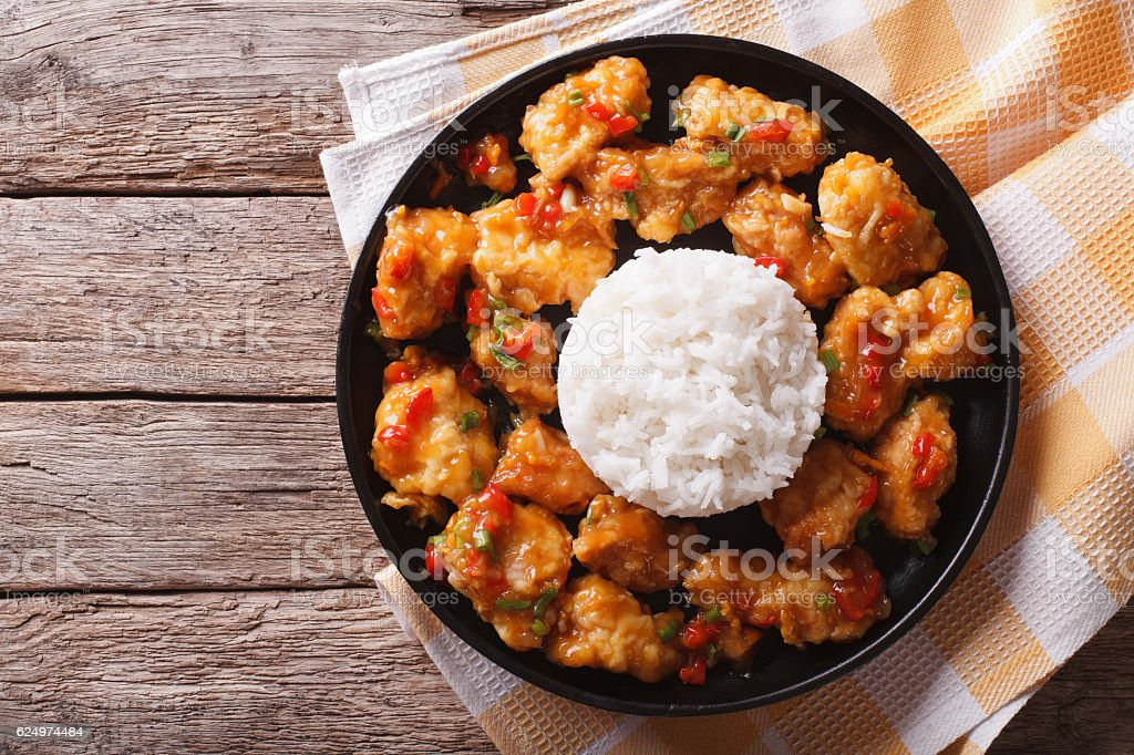 chicken in orange sauce with rice. horizontal top view stock photo
