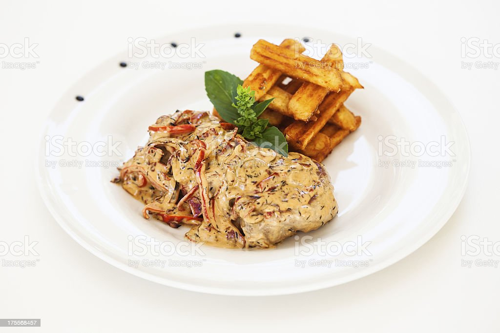 Chicken in souce with fries royalty-free stock photo