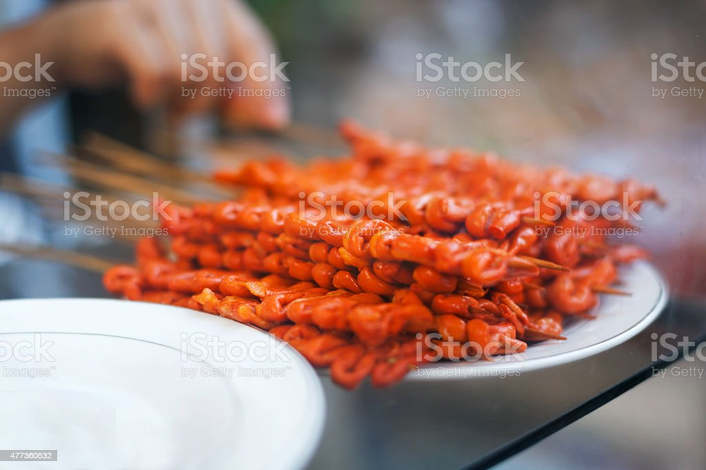 Chicken intestines, pig ears and pig intestines barbeque screw, stock photo