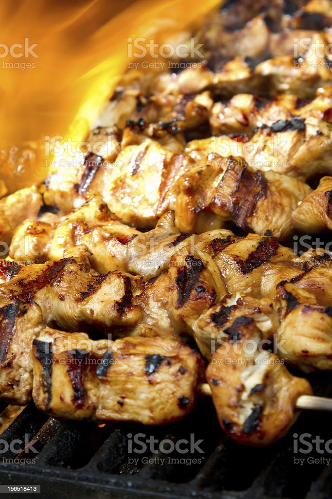 Chicken Kabobs on Flaming Grill royalty-free stock photo
