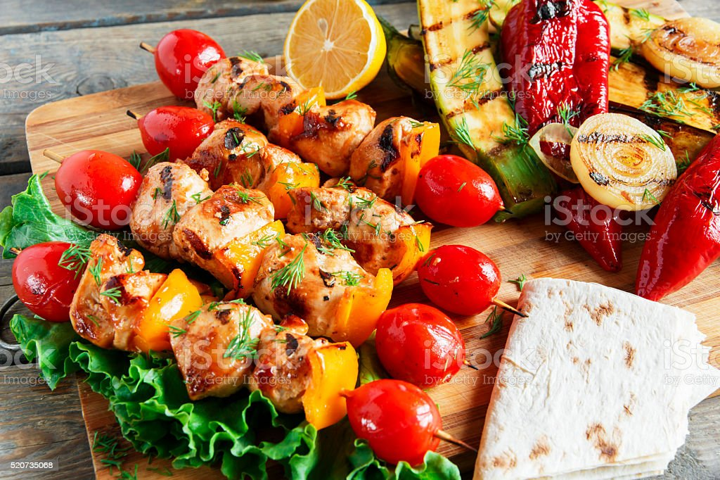 chicken kebab skewer with grilled vegetables barbecue stock photo