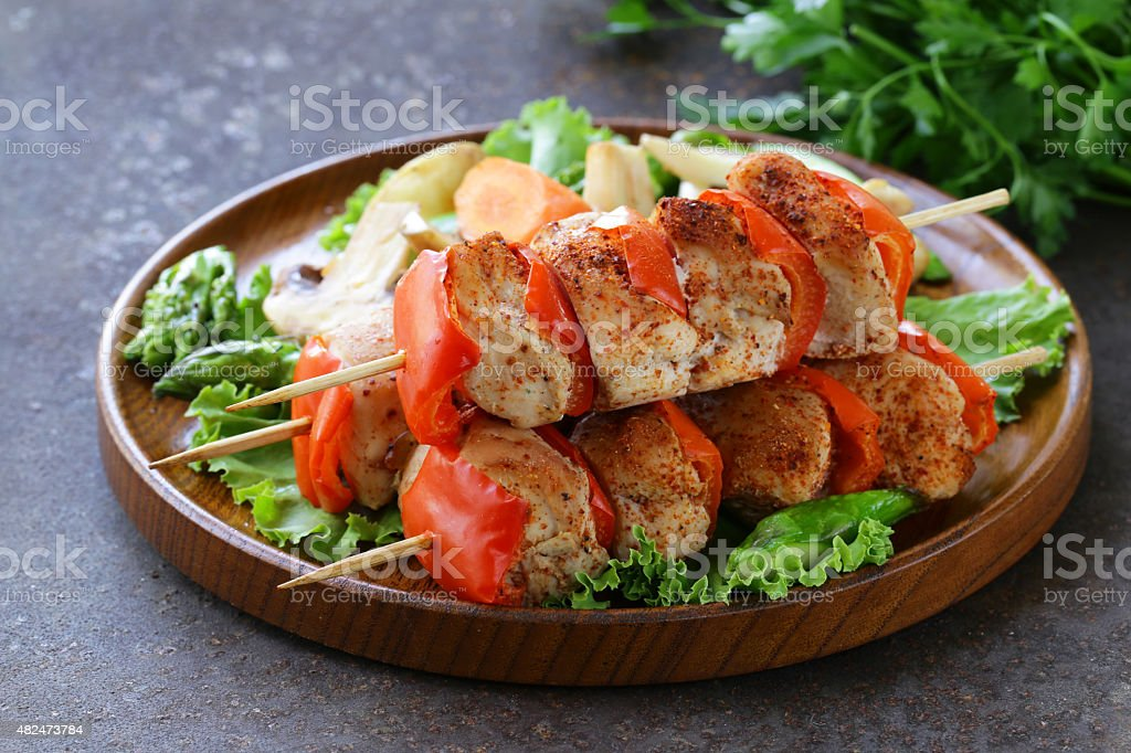 Chicken kebab with bell pepper on wooden skewers stock photo