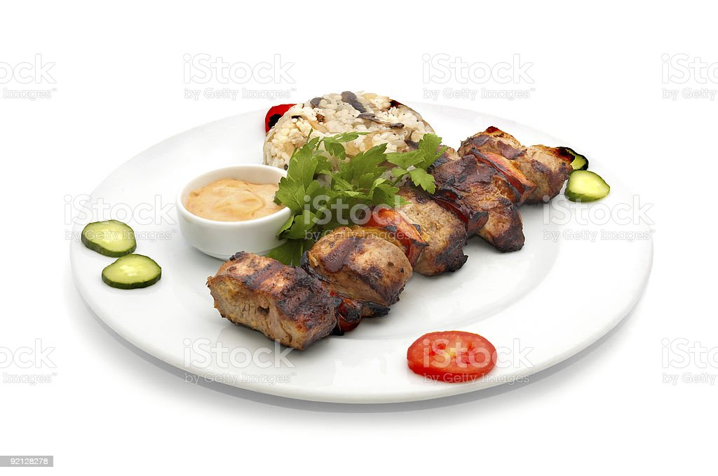 chicken kebab with rice and mushrooms stock photo