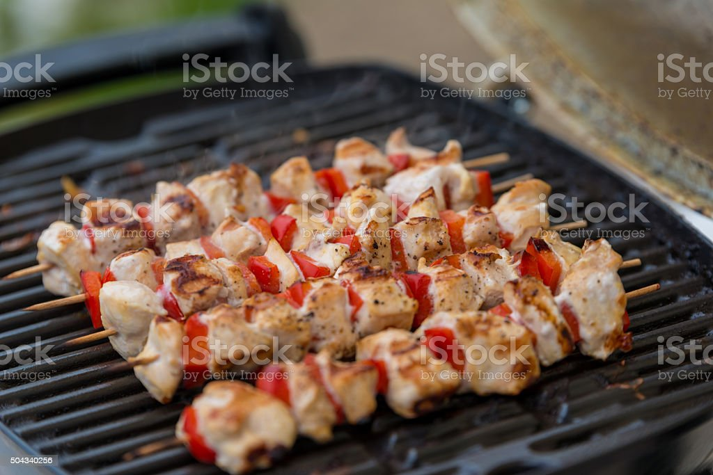 Chicken kebabs on barbecue stock photo