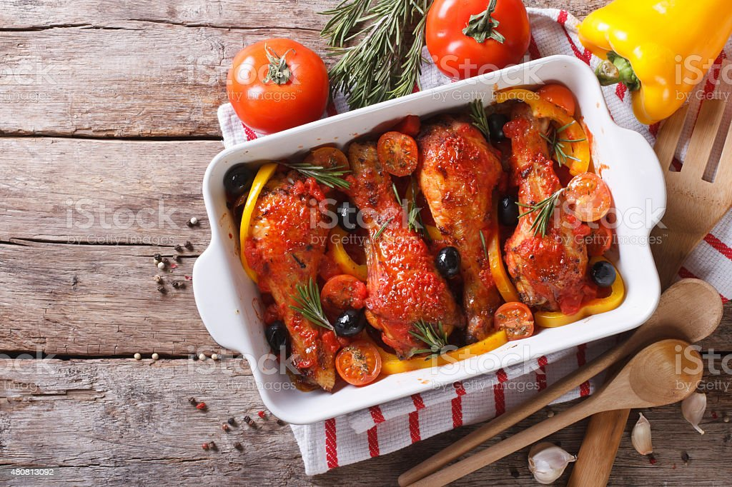 Chicken legs baked in tomato sauce horizontal top view stock photo