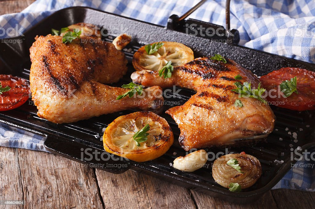 Chicken legs grilled on a grill pan close-up. horizontal stock photo