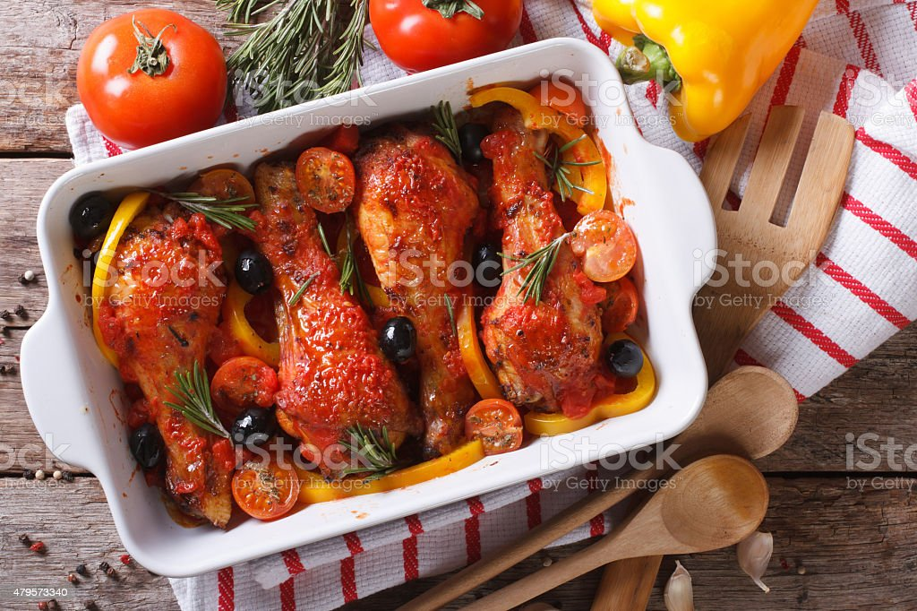 Chicken legs in tomato sauce with olives horizontal top view stock photo