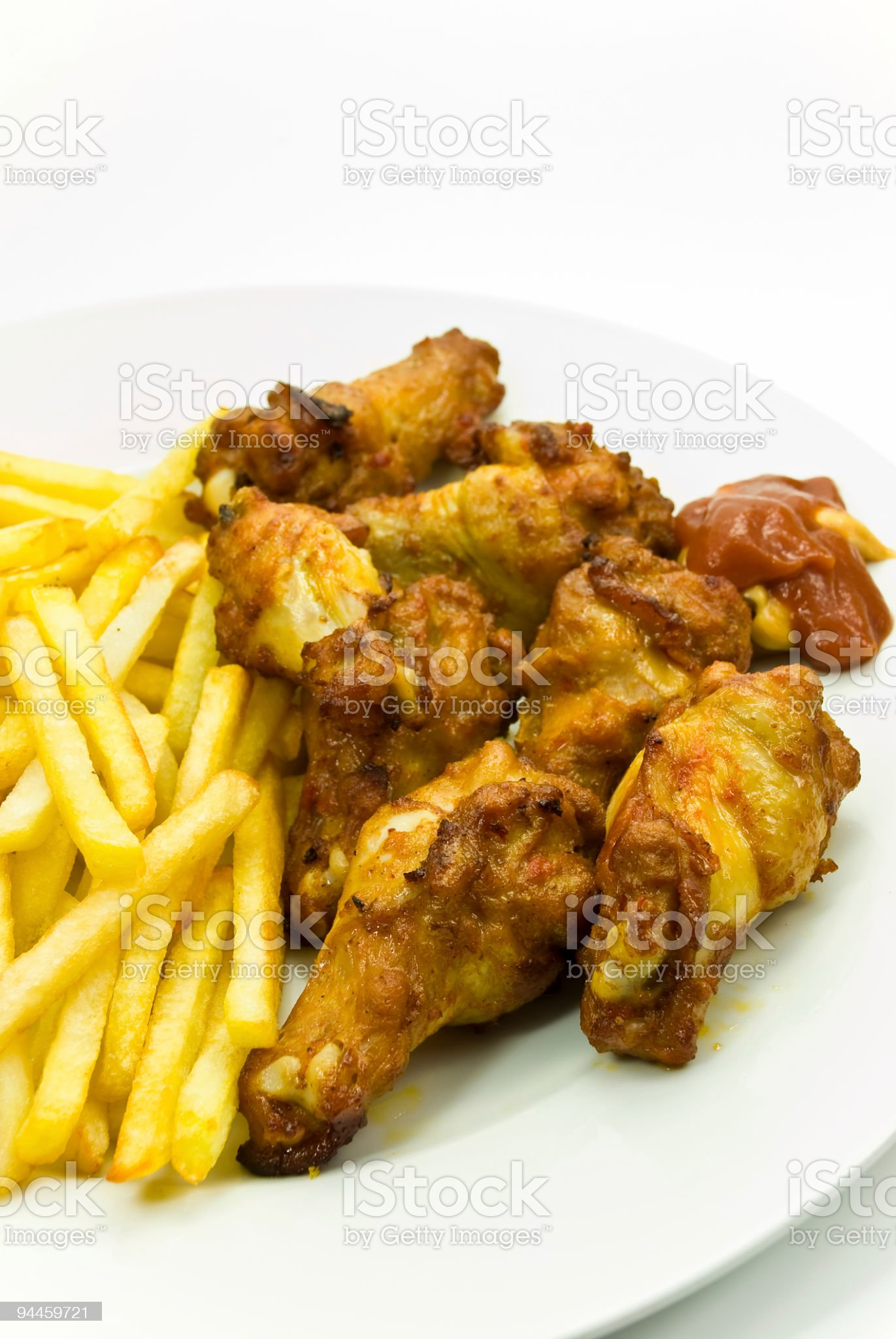 chicken legs with french fried potatoes royalty-free stock photo