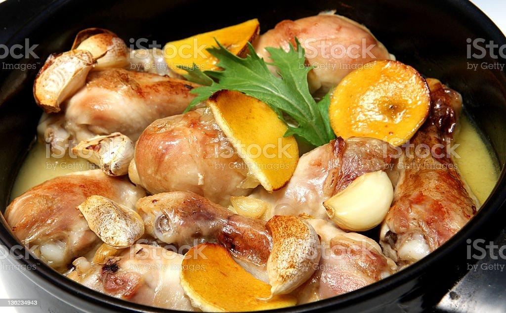 Chicken legs with lemon and garlic stock photo