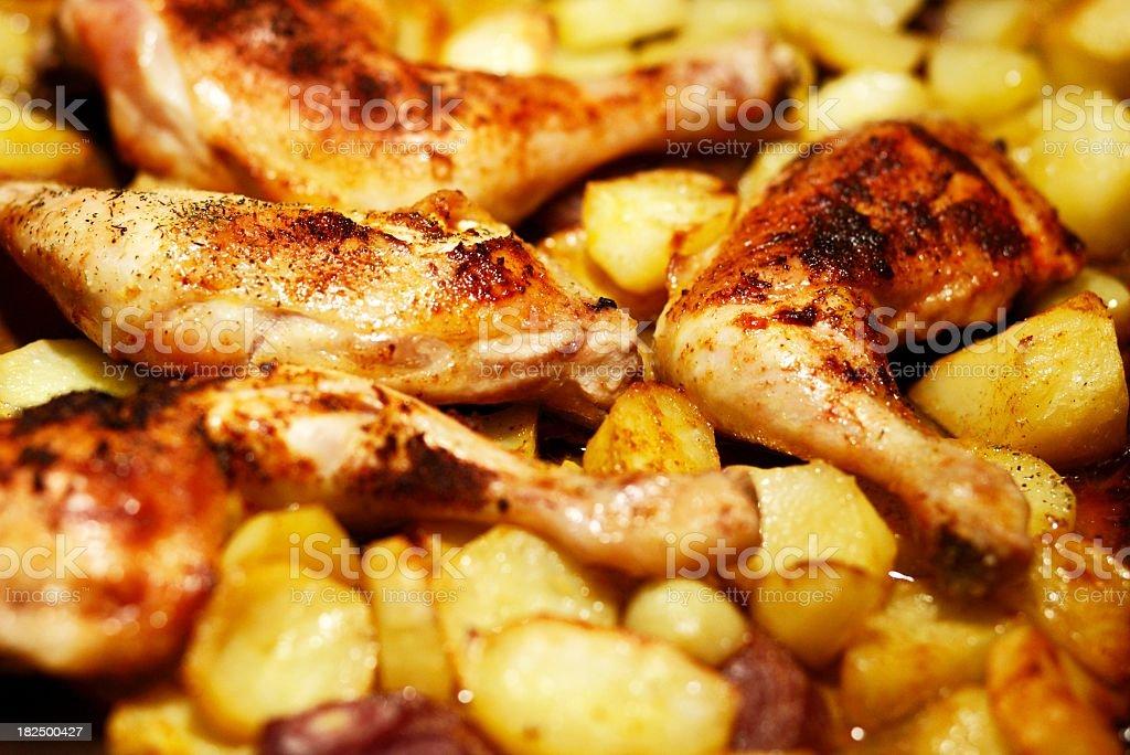 chicken legs with potatos - ready baked stock photo