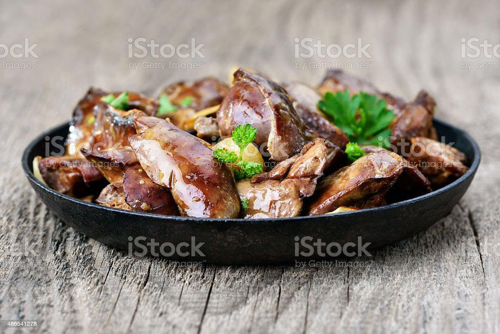 Chicken liver in frying pan stock photo