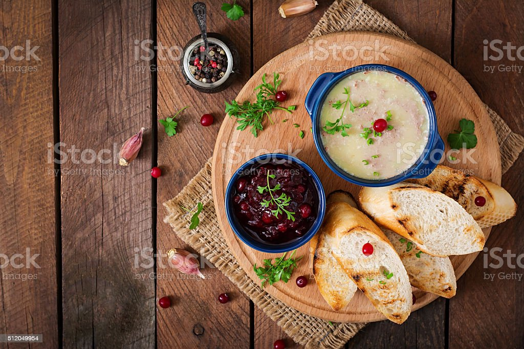 Chicken liver pate with cranberry sauce, served with croutons stock photo