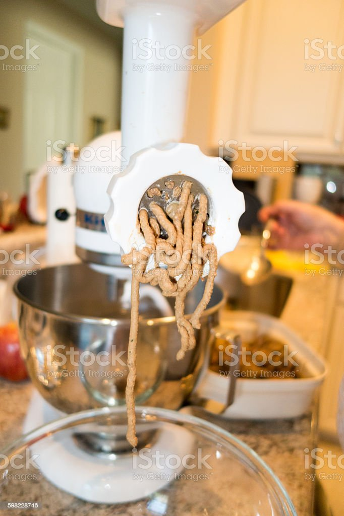Chicken livers being grinded up to make chopped liver stock photo