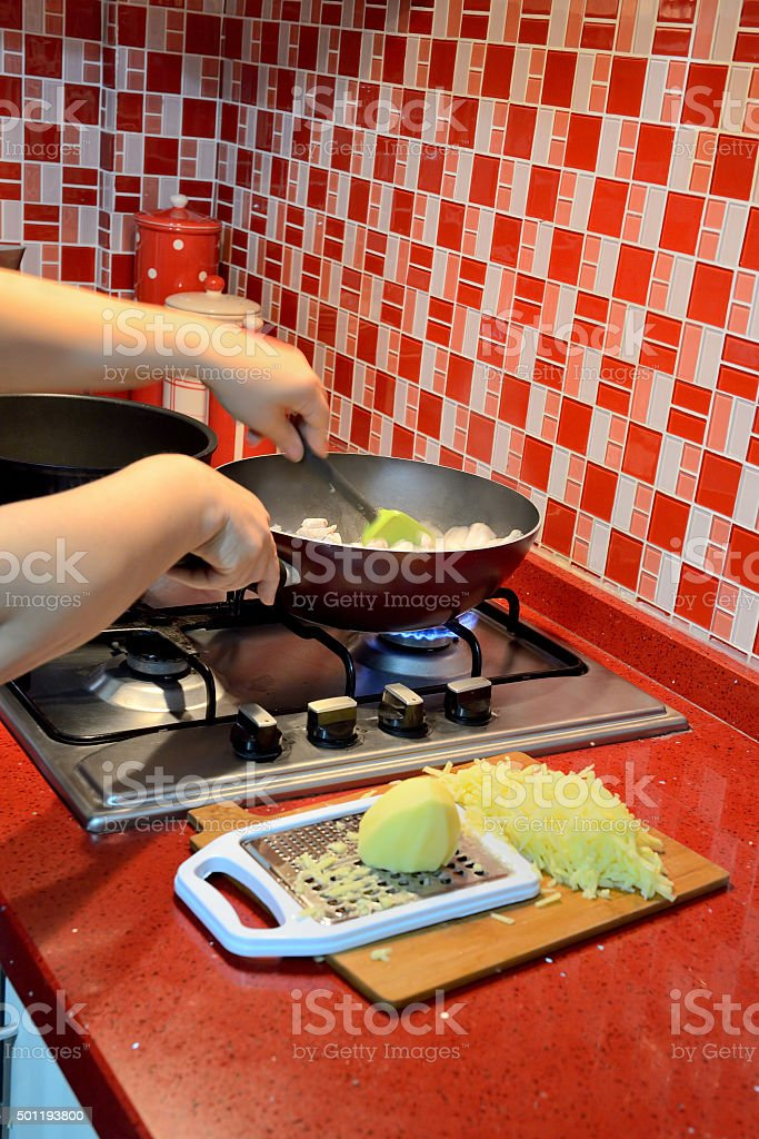 Chicken meat cooking in pan stock photo