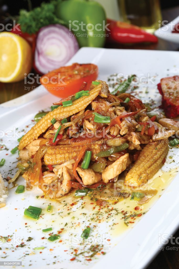 Chicken meat with corn and rice stock photo