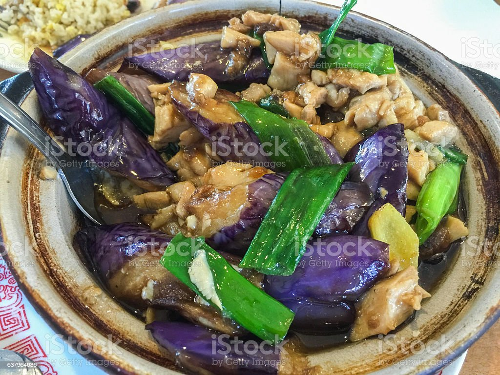 Chicken meat with eggplant and grin onion stock photo