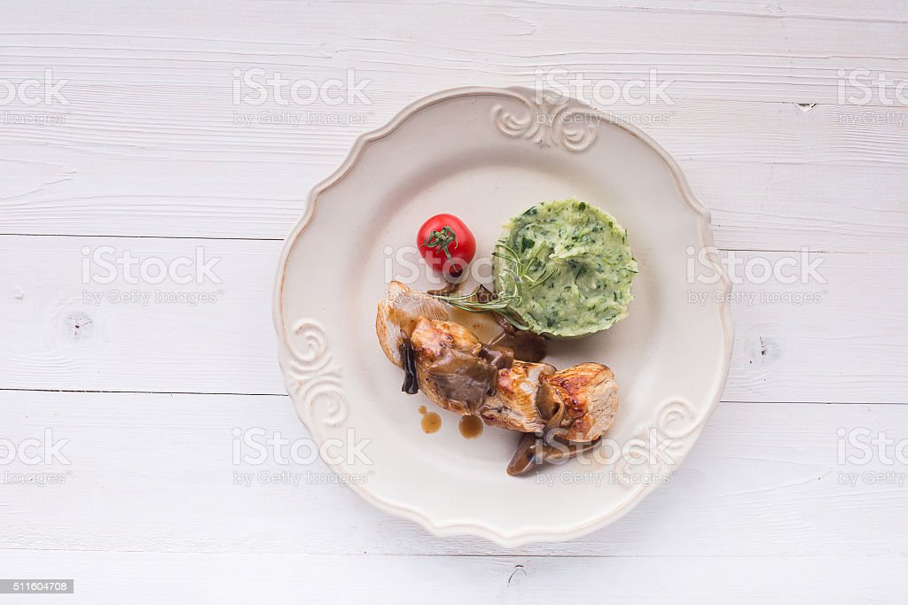 chicken meat with mashed potatoes over white table stock photo