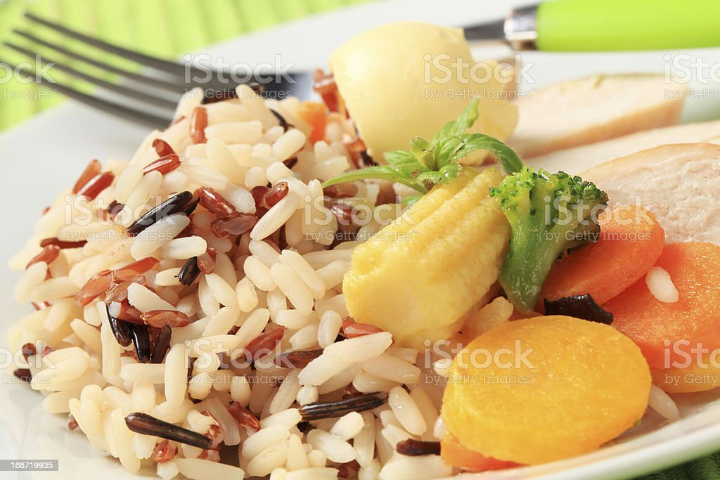 Chicken meat with mixed rice and vegetables royalty-free stock photo