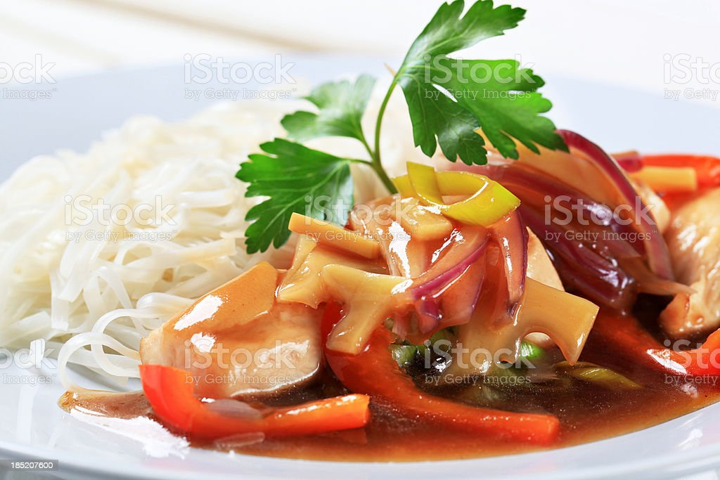 Chicken meat with rice noodles stock photo