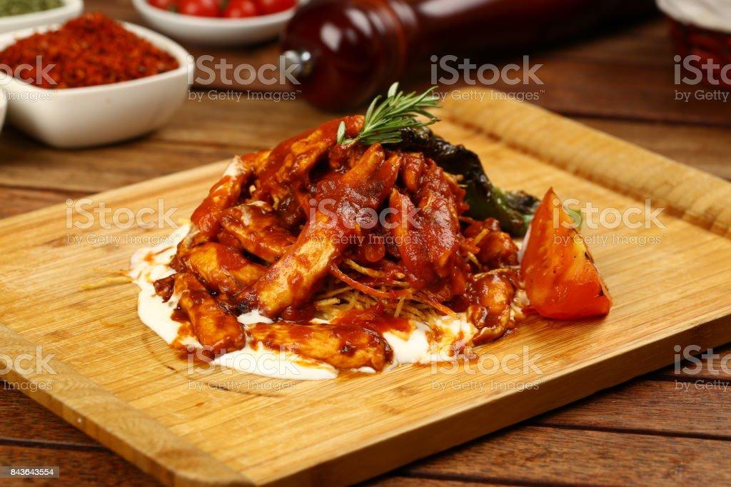 Chicken meat with tomato sauce and yogurt stock photo