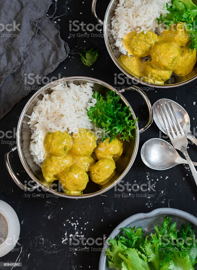 Chicken meatballs in curry sauce and rice stock photo