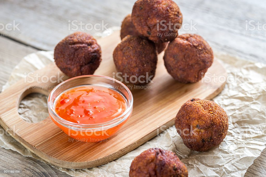 Chicken meatballs with spicy thai sauce stock photo
