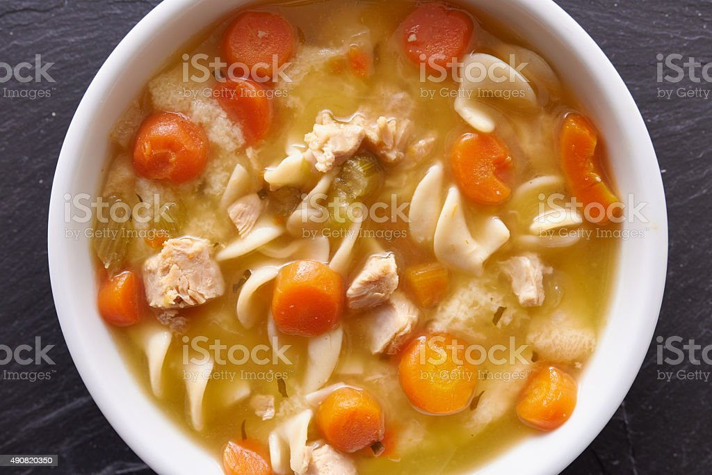chicken noodle soup top down photo close up stock photo
