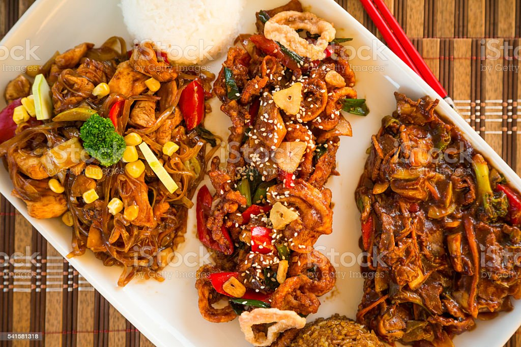 Chicken noodles, stir-fried squids and beef with broccoli. stock photo